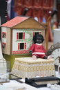 The black doll leaning against a wooden toy house. Royalty Free Stock Photo