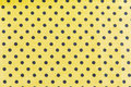 Black dots on yellow background fabric and tiny polka Stock Photo