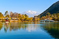 Black dragon pool park lijiang old town scene in the there you can see jade snow mountain Royalty Free Stock Photography