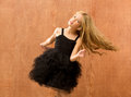 Black dress kid girl dancing and twisting vintage Stock Photography