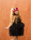 Black dress kid girl dancing on vintage background Stock Images
