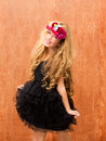 Black dress kid girl dancing on vintage background Stock Photo