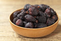 Black dried figs on a wooden surface selective focus Royalty Free Stock Image