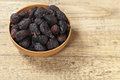 Black dried figs on a wooden surface selective focus Royalty Free Stock Photography