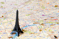 Black eiffel tower over map paris Royalty Free Stock Images