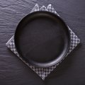Black empty plate on the table. top view Royalty Free Stock Photo