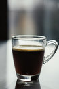 Black espresso coffee with heady froth in a glass mug or cup Royalty Free Stock Photo