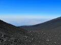Black etna volcano s rocks and bly sky Stock Photo