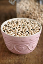 Black eye peas eyed in a pink bowl shgot with a shallow depth of field Stock Photography