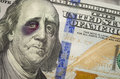 Black eyed ben franklin on new one hundred dollar bill bruised battered and the newly designed united states Royalty Free Stock Photo