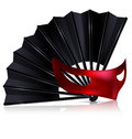 Black fan and red mask white background the with half Stock Photo