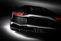 Black fast sports car in spotlight, black background. Shiny, new, luxurious. Royalty Free Stock Photo