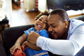 Black father enjoy precious time with his child together happine Royalty Free Stock Photo