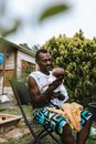 Black father holding and looking at his baby boy Royalty Free Stock Photo