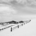 Black fence on white snow on mountains minimalism concept of calmness Stock Images