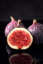 Black figs  on black board and dark reflections Royalty Free Stock Photo