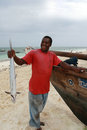Black fisherman from the island of Zanzibar holding mackerel Royalty Free Stock Photo