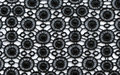 Black flowers lace material texture macro shot Royalty Free Stock Photo