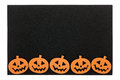 Black foam halloween mat with jack o lanterns orange lantern border copyspace isolated on white Stock Photo