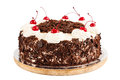 Black forest cake decorated with whipped cream and cherries Royalty Free Stock Photo
