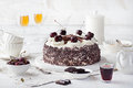 Black forest cake ,decorated with whipped cream and cherries Schwarzwald pie, dark chocolate and cherry dessert
