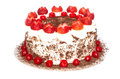 Black forest cake full well decorated with cherries and strawberries Stock Image