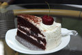 Black forest cake on the glass table Royalty Free Stock Images
