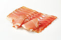 Black forest ham thin slices of dry cured smoked schwarzwald on white background Stock Images