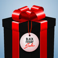 Black friday sale advertising vector illustration, black gift box with red bow Royalty Free Stock Photo