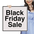 Black friday sale a woman holding a signboard Royalty Free Stock Images
