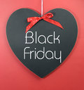 Black Friday shopping sale concept with message on a heart shape blackboard Royalty Free Stock Photo
