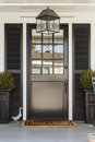Black front door to a family home with porch Royalty Free Stock Photo