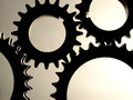 Black gears over white and gray background Royalty Free Stock Image
