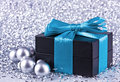 A black gift with a blue ribbon and a bow Royalty Free Stock Photos