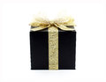 black gift box with golden ribbon and shining net bow isolated on white background Royalty Free Stock Photo