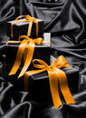 Black gift boxe with yellow satin ribbons Royalty Free Stock Photo