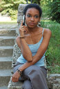 Black girl with mobile phone Stock Image