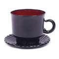 Black glass cup of tea with a saucer Stock Images