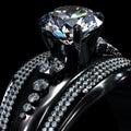 Black gold coating engagement ring with diamond gem. Royalty Free Stock Photo