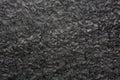 Black granite texture on macro. Royalty Free Stock Photo