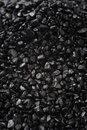 Black granular texture of granulat for abstract background Royalty Free Stock Photos