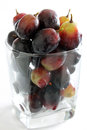 Black grapes in a glass closeup of Royalty Free Stock Image