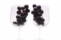 Black grapes into wine glasses in two Stock Photos