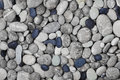 Black and gray pebbles for background for spa, natural macro texture Royalty Free Stock Photo