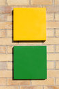 Black green yellow signs brick wall copy space Royalty Free Stock Image