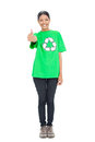 Black haired model wearing recycling tshirt giving thumb up on white background Royalty Free Stock Photos