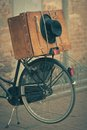 Black hat and brown suitcase on old bike Royalty Free Stock Photo