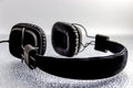 Black headphone on top of a frosted glass Stock Photography