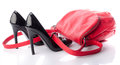 Black high heels shoes with a red handbag Royalty Free Stock Photo