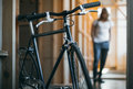 Black hipster bicycle and man walking behind Royalty Free Stock Photo